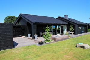 Holiday home 54191 in Høll / Hvidbjerg for 10 people